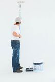 Man using paint roller on white background Royalty Free Stock Photography