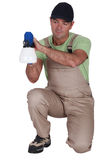 Man using paint sprayer Royalty Free Stock Image