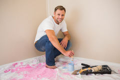 Man using paintbrush to paint wall blue Stock Photos