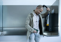 Man using pay phone Stock Photos