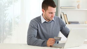 Man using a payment card online stock footage