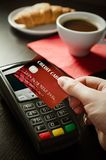 Man using payment terminal with NFC technology Royalty Free Stock Photography
