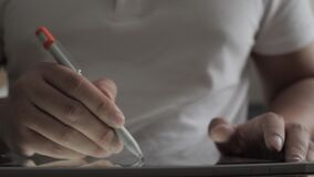 Man using pen stylus to draw on his digital tablet. Illustrator working on project or doing photo editing
