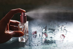 Man using perfume Stock Photography