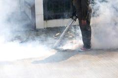 Man using pest control machine. Man using smoke machine of pest control for mosquito preventive Stock Photos