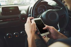 Man using phone in the car Stock Photos