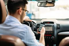Man using phone while driving the car. Transportation concept - man using phone while driving the car Royalty Free Stock Photography