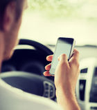 Man using phone while driving the car Stock Photo