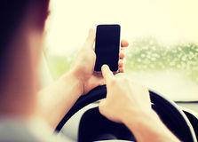 Man using phone while driving the car Royalty Free Stock Image