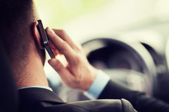 Man using phone while driving the car Stock Photography