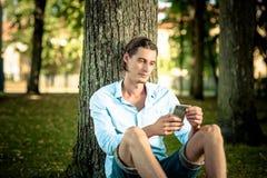 Man using phone outdoors royalty free stock photos
