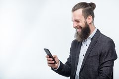Man using phone technology communication gadgets. Smiling man using mobile phone. technology communication and modern gadgets royalty free stock photos