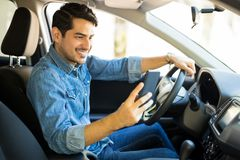 Free Man Using Phone While Driving Car Royalty Free Stock Photography - 122124767