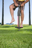 Man using a pogo stick Stock Image