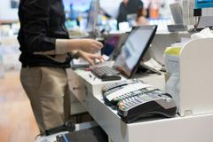 Man using pos terminal at the shop paying credit card for purch Stock Photography