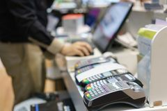 Man using pos terminal at the shop paying credit card for purch Stock Image