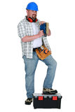 Man using power sander Stock Image