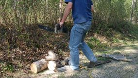 A man using a power saw to cut wood stock video footage