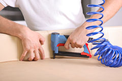 Man using a power tool Stock Photography