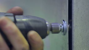 Man using power tool screwdriver for screwing bolts and nuts at industrial factory. stock video footage