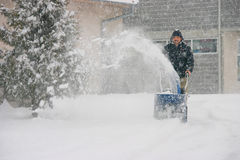 Man using a powerful snow blower. In wintertime royalty free stock images