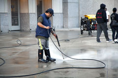 Man using pressure washer Stock Photos