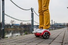 Man is using the red hoverboard. Against the background of the river Royalty Free Stock Images