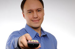 Man using remote. Man in a shirt using remote control Royalty Free Stock Images