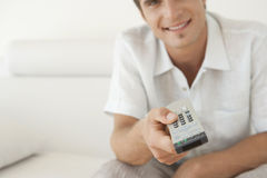 Man Using a Remote Control Stock Photography