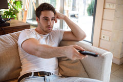 Man using remote controller Stock Photo