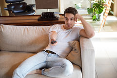 Man using remote controller Stock Photography