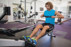Man using resistance band in gym Royalty Free Stock Photos