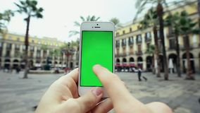 Man Using Smart Green Screen Phone Outdoors stock video footage