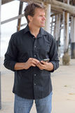 Man using smart phone at beach Royalty Free Stock Photography