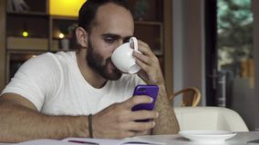 Man using smart phone. And drinking coffee stock video