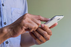 Man using smart phone Stock Image