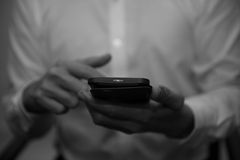 Man is using a smart phone. Men are playing phone, a black and white photo Royalty Free Stock Photography