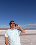 Man using smart phone outdoors Stock Photos