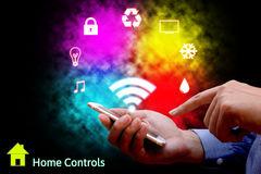 Man using smart phone or remote home control online home automat Stock Images