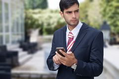 Man using a smart phone on the street Royalty Free Stock Images