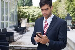 Man using a smart phone on the street Royalty Free Stock Photography