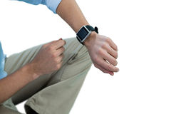 Man using smart watch against white background Stock Photo