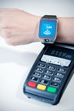 Man using smart watch with NFC chip. Royalty Free Stock Image