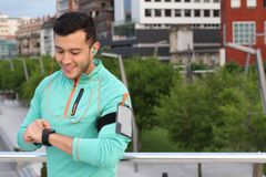 Man using smart watch outdoors.  Stock Photos