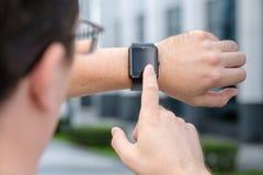 Man using smart watch. Outdoors Stock Photos