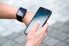 Man using smart watch. Outdoors Stock Image