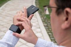 Man using smart watch. Outdoors Stock Photo