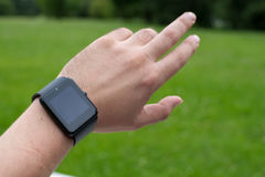 Man using smart watch. Outdoors Royalty Free Stock Photo