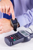 Man using smart watch to express pay Stock Image