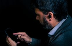 Man using smartphone and bluetooth headphones stock photos